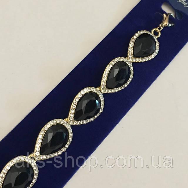Серебряный браслет с черными камнями в виде капли со стазами по кругу