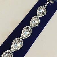 Серебряный браслет с камнями в виде капли со стазами по кругу
