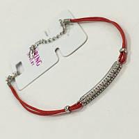 Трендовый браслетик: красная нить с серебряной вставкой дорожка с фианитами