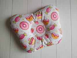 Ортопедическая подушка для новорожденных розового цвета