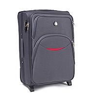 Средний дорожный чемодан на двух прорезиненных колёсах фирмы WINGS 1708 M Grey