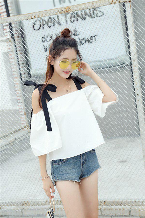 Женская белая блуза с черными атласными лентами
