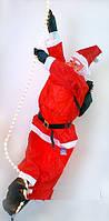 Санта на лестнице декоративный