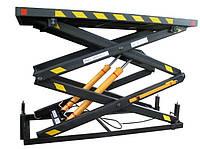 Подъемный стол шахтного типа грузовой.