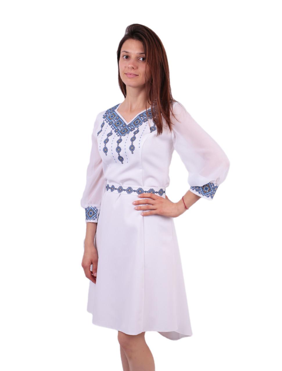 be7a8894306c10 Вишите біле плаття недорого з машинною вишивкою голубого кольору -  Інтернет-магазин вишиванок для всієї