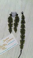 Набор украшений длинные серьги и браслет в черном металле со светло зелеными кристаллами