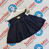 Детские школьные юбки для девочек кожзам в цветы оптом TYLKOMET