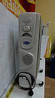 Масляный радиатор Alpari 1,5 кВт с вмонтированным вентилятором.