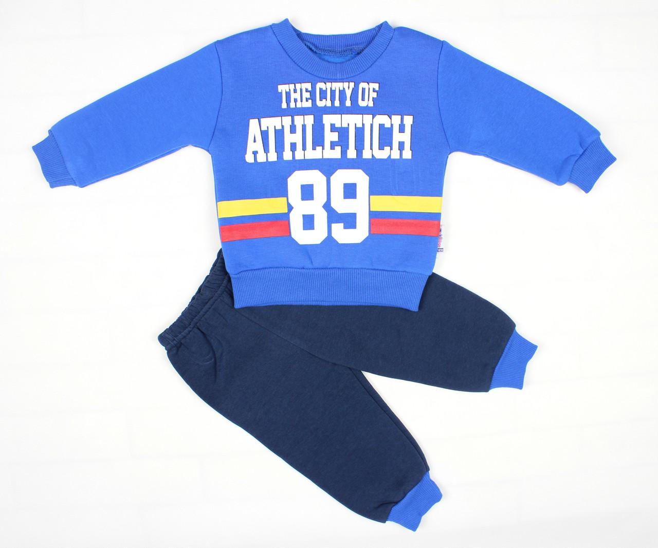 Теплый зимний спортивный костюм синим цветом для мальчика