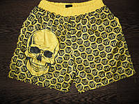 Шорты с черепом PHILIPP PLEIM желтые.