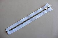 Молния металлическая YКК , размер № 5, длинна - 18 см., тесьма - белая, цвет зубьев - никель, артикул СК 5243