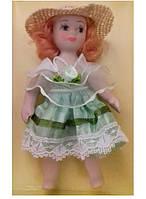 Фарфоровая кукла в праздничном платье