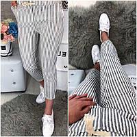 Красивые брюки с модным принтом полоска