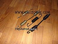 Пружина стяжная передних тормозных колодок Foton AC3251/2, HOWO