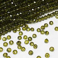 Бусины хрустальные (Рондель)  4х3мм пачка - 135 шт, цвет - оливковый прозрачный глянец
