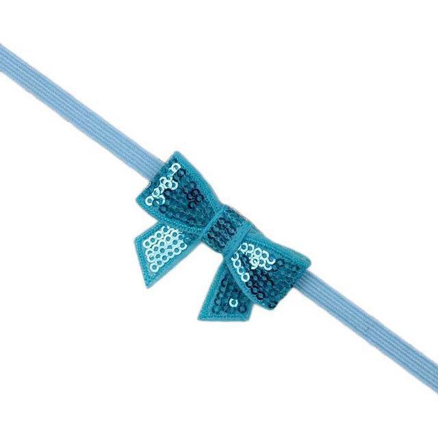 Повязка Бантик на голову для девочки от 0 до 1 года голубой