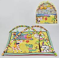 Развивающий коврик с подвесками игрушек