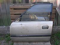 Дверь передняя левая б/у на Mazda 626 хэтчбек год 1987-1992