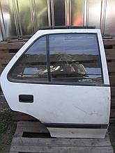 Дверь задняя правая б/у на Suzuki Swift год 1995-2003 (седан)