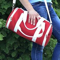 7516b9c8899c Женская спортивная сумка ярко красного цвета с белыми кожаными ручками и  ремнем