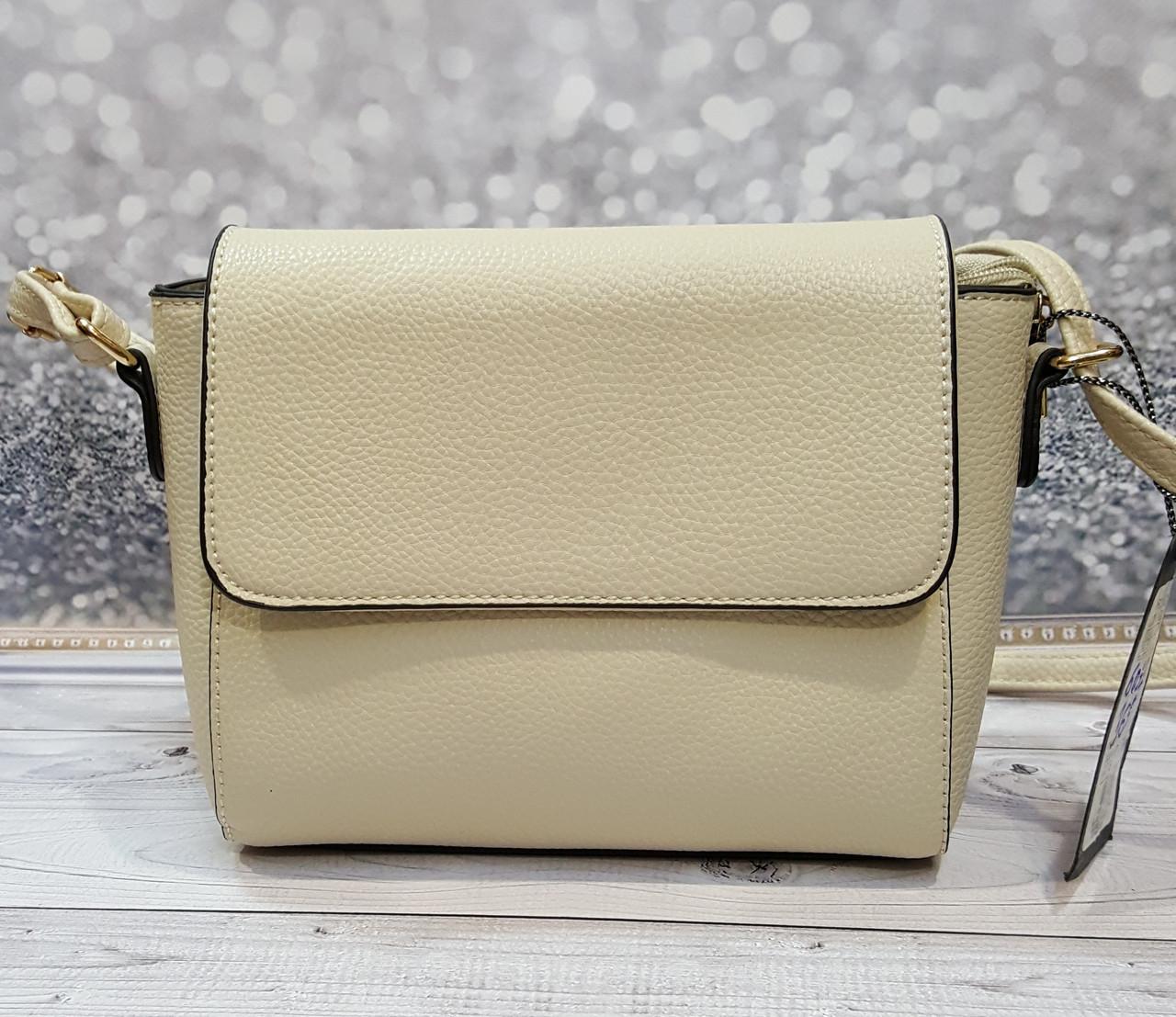 Женская сумка молочного цвета