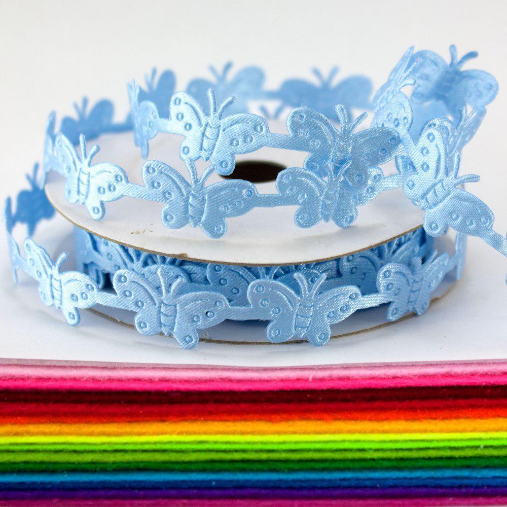 "(10 ярдов) Лента резная ""Бабочки"" ширина 1,5 см. Цена за бобину ≈ 9,15 метра Цвет - Голубой"