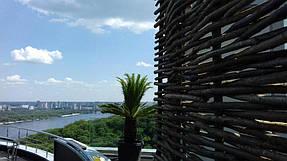 Оформление зоны отдыха на крыше здания, декоративный забор 3