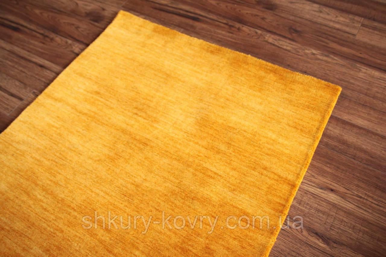 Ковер из натуральной шерсти оранжевого цвета тканный вручную