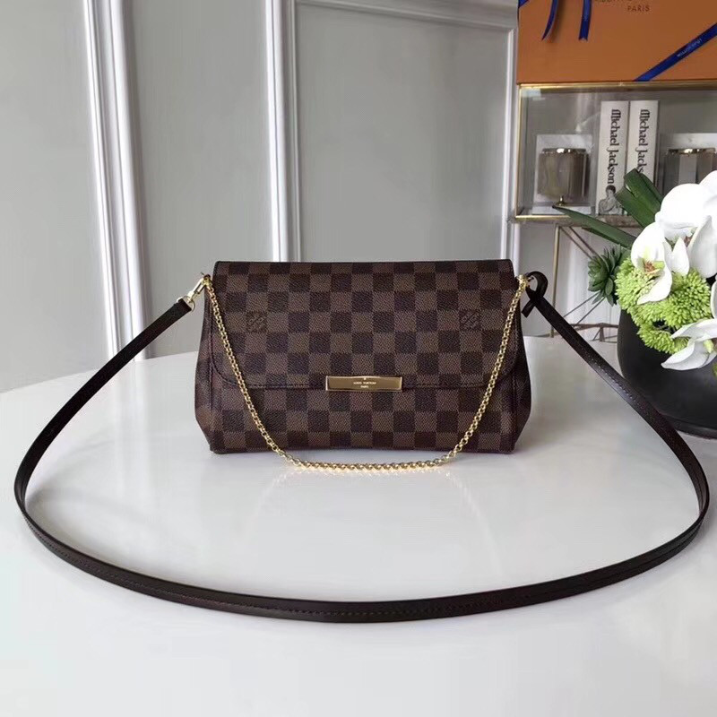 f0c45b906320 Женский клатч Louis Vuitton Favorite, Damier Ebene, цена 5 400 грн ...