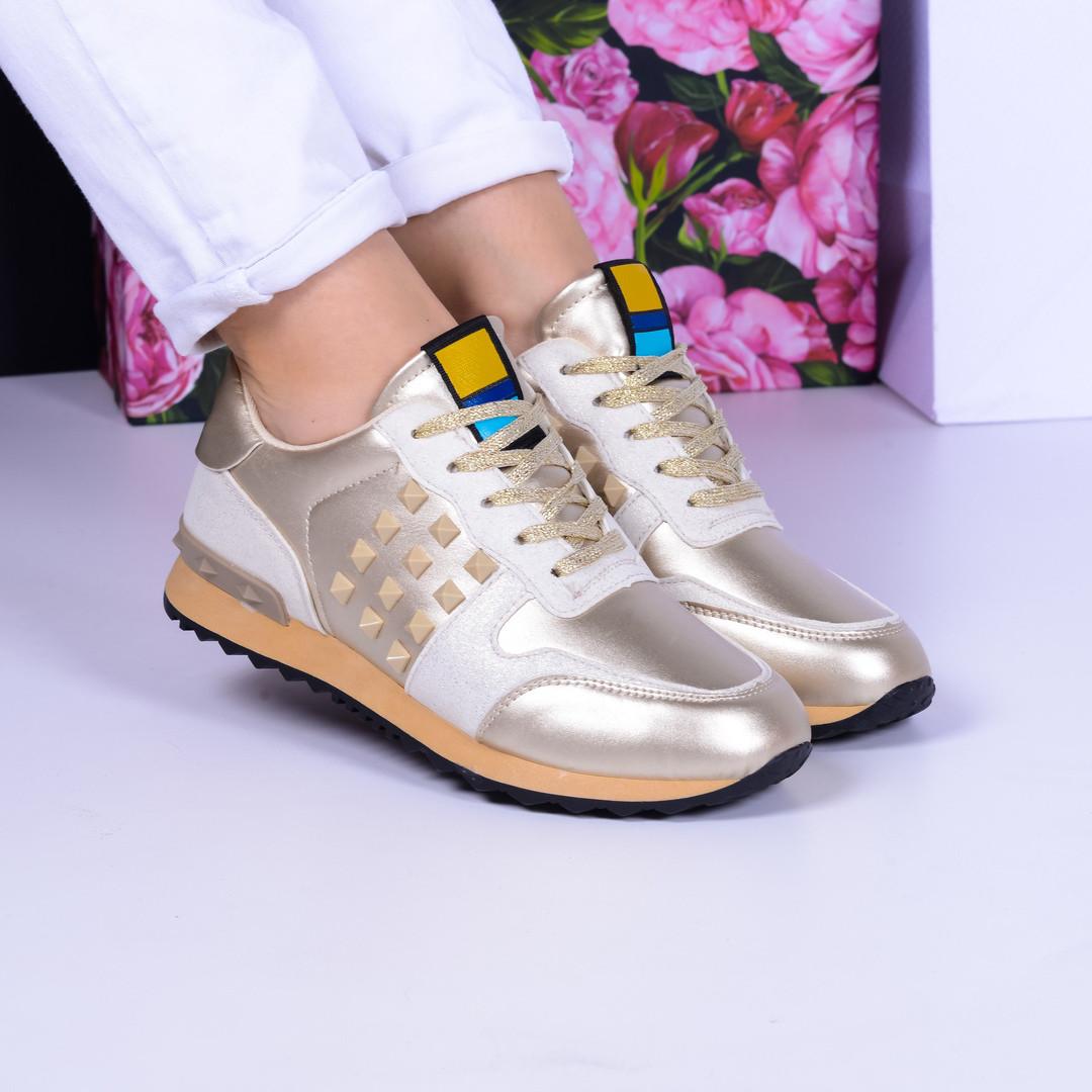 Кроссовки Vintage с шипами золото