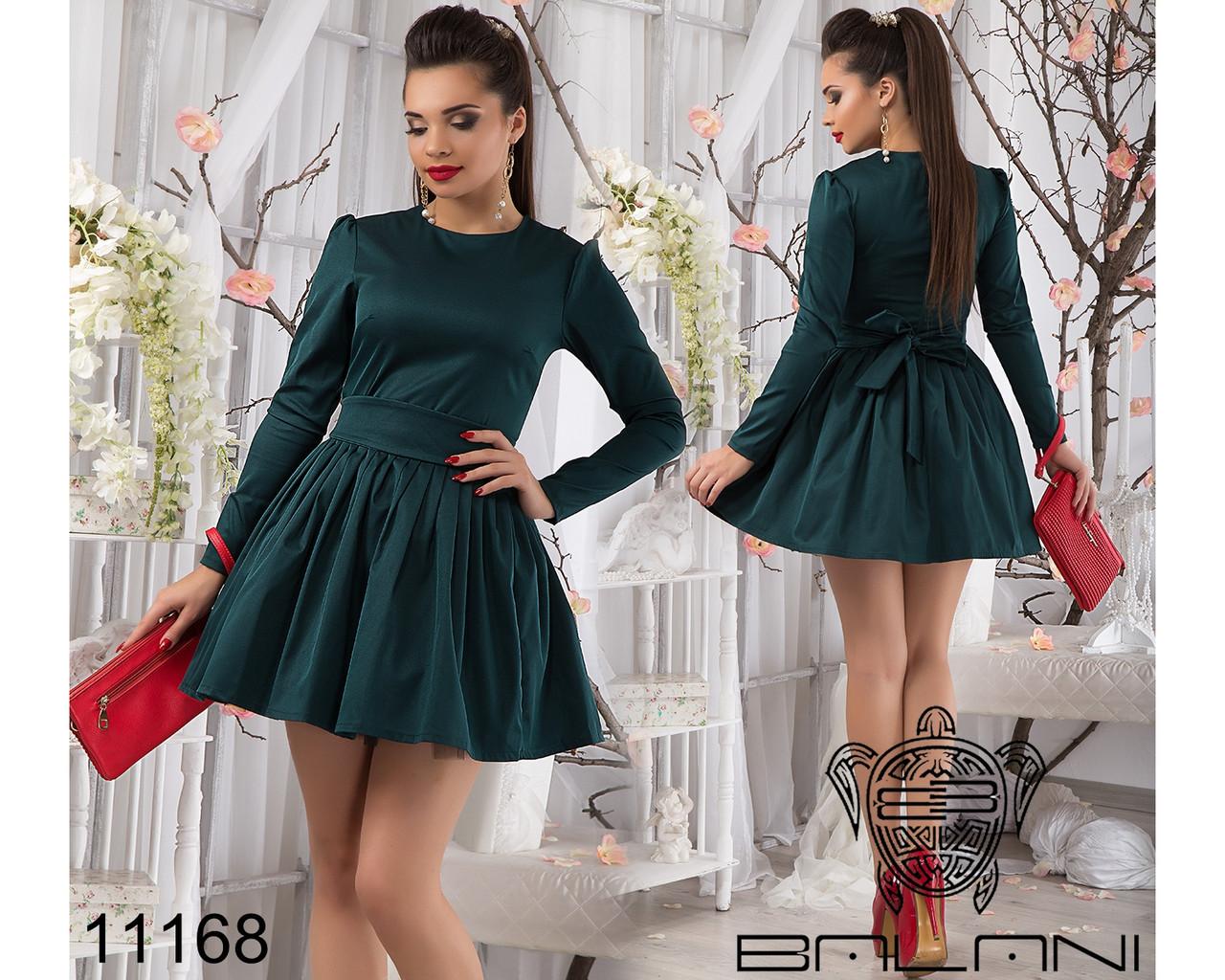 Зеленое короткое платье с пышной юбкой