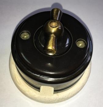 Выключатель накладной поворотный ZION черный глянец металлическая ручка