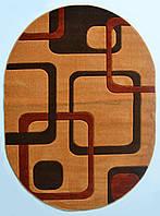 Яркий оранжевый ковер овальной формы Melisa