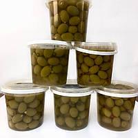 Греческие зеленые оливки фаршированные корнишонами 600г
