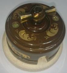 Выключатель накладной ZION керамический «Магия золота» бантик металлический