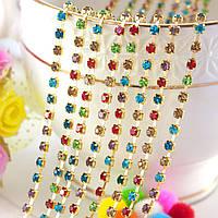 (7,4 метра) Стразовая цепочка одинарная (ширина 2,5мм) Цвет оправы-золото, цвет камней- разноцветные