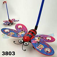 Каталочка игрушка для малышей 3803-11  бабочка Микки Маус, на палочке, в пакете 35*20 см.