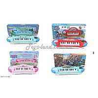 Музыкальный орган 6889-144/5/6/7  4 вида микс,  батарейки ,  музыкальная игрушка детская , в коробке 37*17*6 см.