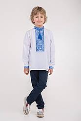 Вышитая сорочка на мальчика с синим орнаментом