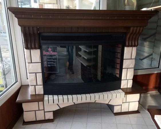 Каминокомплект Fireplace Дубай облицовка портала имитирует рваный камень с встроенным электроочагом