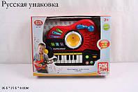 Гитара-музыкальный орган 7163  батарейки ,  звук,    свет,  в коробке  35,5*27,5*8 см.