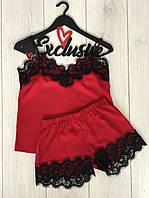 Красный комплект с кружевом майка и шорты.