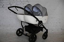 Дитяча коляска для двійні Junama Madena Duo