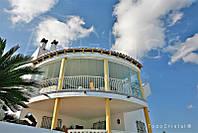 Остекление фасадов. Безрамное остекление Todocristal. Дизайн балкона