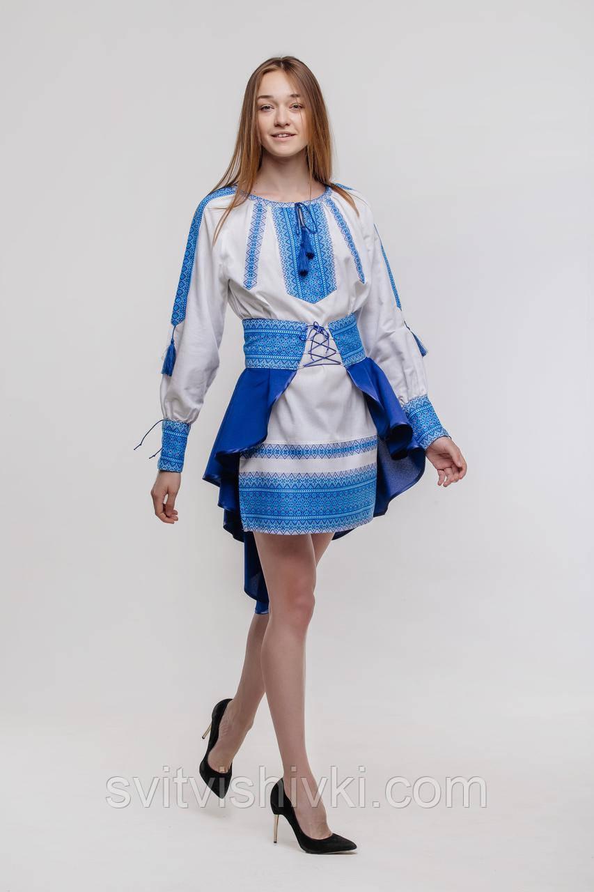 Костюм с вышивкой синего цвета