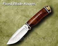 Нож охотничий. Рукоять - наборная кожа, латунь.