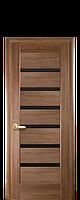 Межкомнатная дверь  Линнея ПВХ DeLuxe с черным стеклом,цвет ольха золотая
