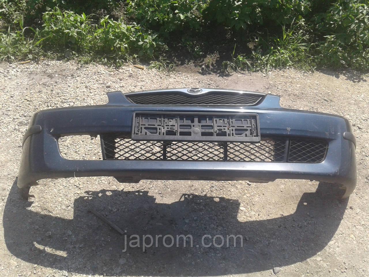 Бампер передний Mazda 323 BJ 1997-1999г.в. синий дорестайл