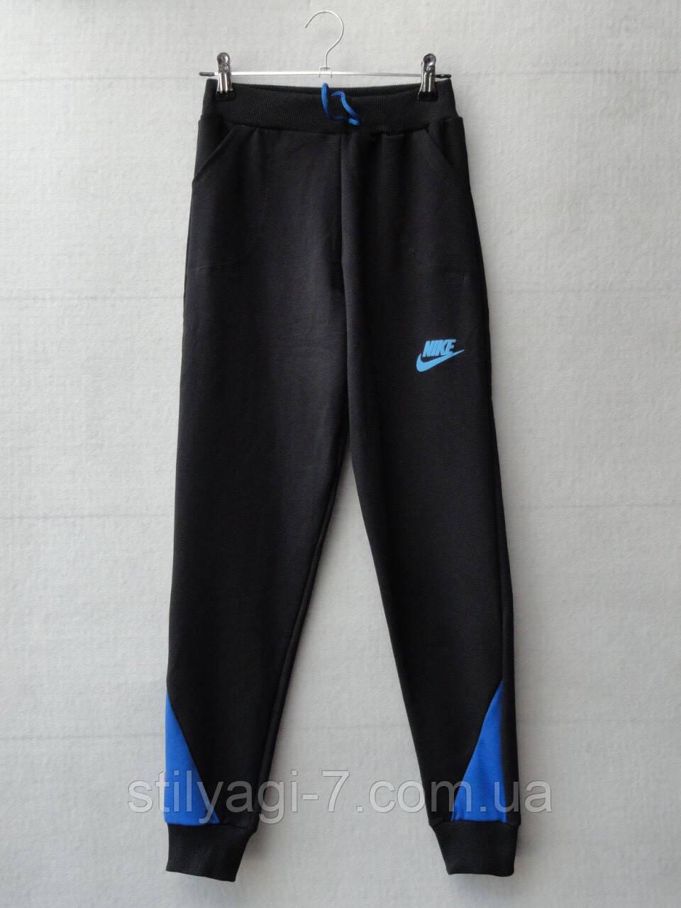 Спортивные штаны для мальчика на 4-8 лет синего цвета Nike оптом