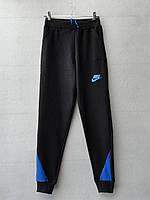 Спортивные штаны для мальчика на 8-12 лет синего цвета Nike оптом
